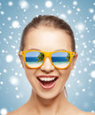 Happy screaming teenage girl in shades picture of Stock Photo