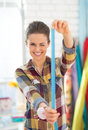Happy seamstress using measuring tape Royalty Free Stock Photo