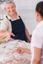 Happy seller of fish Royalty Free Stock Photo