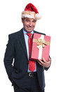 Happy senior business man holding a big present box and smiles to the camera Stock Images