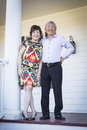 Happy senior chinese couple enjoying their house attractive outside Royalty Free Stock Photography