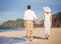Happy senior couple on the beach. Retirement Luxury Tropical Res Royalty Free Stock Photo