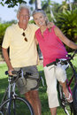Happy Senior Couple on Bicycles In Green Park Royalty Free Stock Image