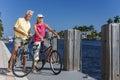 Happy Senior Couple On Bicycle...