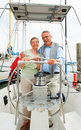 Happy senior couple on a boat voyage at the sea Royalty Free Stock Photos