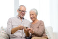 Happy senior couple with camera at home family technology age and people concept Stock Images