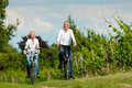 Happy senior couple cycling outdoors in summer Royalty Free Stock Photo