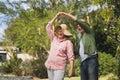 Happy senior couple dancing at yard Royalty Free Stock Photo