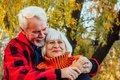 Happy senior couple enjoying each other in the park. Support and care from a loved one, warm emotions Royalty Free Stock Photo