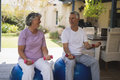 Happy senior couple exercising together at porch Royalty Free Stock Photo