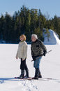 Happy senior couple having fun exercising snowshoes lake winter Stock Photography
