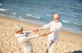 Happy senior couple holding hands on summer beach Royalty Free Stock Photo
