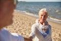 Happy senior couple holding hands summer beach Royalty Free Stock Photo