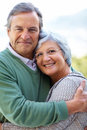 Happy senior couple hugging - Outdoor Stock Image