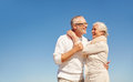Happy senior couple hugging outdoors family love and people concept Stock Photo