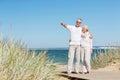 Happy senior couple hugging on summer beach Royalty Free Stock Photo