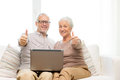 Happy senior couple with laptop at home Royalty Free Stock Photo
