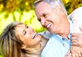 Happy senior couple in love park outdoors Stock Photos
