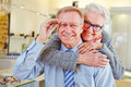 Happy senior couple with new glasses at optician retail store Stock Image