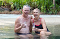 Happy senior couple in pool Royalty Free Stock Images