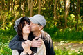 Happy senior couple portrait embraced and kissing standing in the nature Royalty Free Stock Images