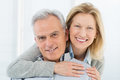 Happy senior couple portrait of smiling at home Royalty Free Stock Photos
