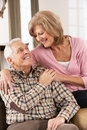 Happy Senior Couple Relaxing At Home Stock Image