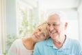 Happy senior couple smiling at home Royalty Free Stock Photo