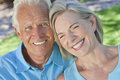 Happy Senior Couple Smiling Outside in Sunshine Stock Images