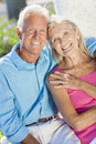 Happy Senior Couple Smiling Outside in Sunshine Stock Photos
