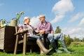 Happy senior couple at summer farm Royalty Free Stock Photo