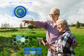 Happy senior couple with tablet pc at summer farm Royalty Free Stock Photo