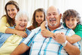 Happy senior couple with their grand children Royalty Free Stock Photography