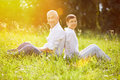 Happy senior couple on vacation in summer relaxing a meadow Stock Photos