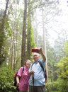 Happy senior hiking in the park Royalty Free Stock Photo