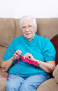 Happy senior knitting Royalty Free Stock Photography
