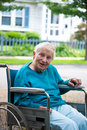 Happy senior lady in wheelchair Stock Photo