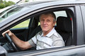 Happy senior man in car Stock Images