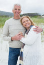 Happy senior man embracing woman at beach portrait of a men women the Royalty Free Stock Photo