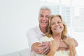 Happy senior man embracing woman from behind portrait of a men women at home Royalty Free Stock Images