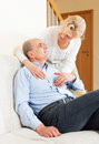 Happy senior man with mature wife men in home interior Stock Image