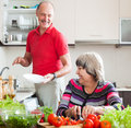 Happy senior man and mature woman doing chores men women together Stock Image