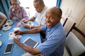 Happy senior man playing cards with friends Royalty Free Stock Photo