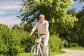 Happy senior man riding bicycle at summer park Royalty Free Stock Photo