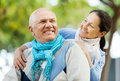 Happy senior man and smiling mature woman men women together against blured trees of park or forest Stock Images
