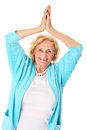 Happy senior a portrait of a lady stretching over white background Royalty Free Stock Images