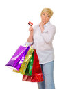 Happy senior woman with bags and credit card Stock Photography