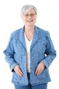 Happy senior woman in denim jacket smiling Royalty Free Stock Photo