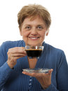 A happy senior woman drinking a cup of coffee Royalty Free Stock Photo