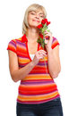 Happy senior woman enjoying red rose Stock Photography